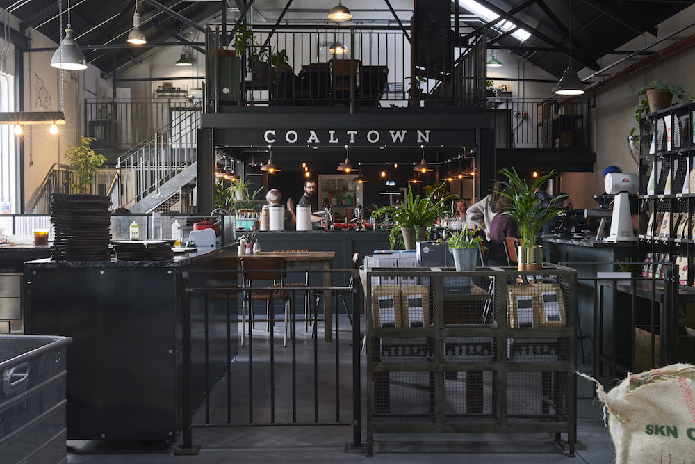 photo of Coaltown Coffee roastery showing the seating area and drinks bar