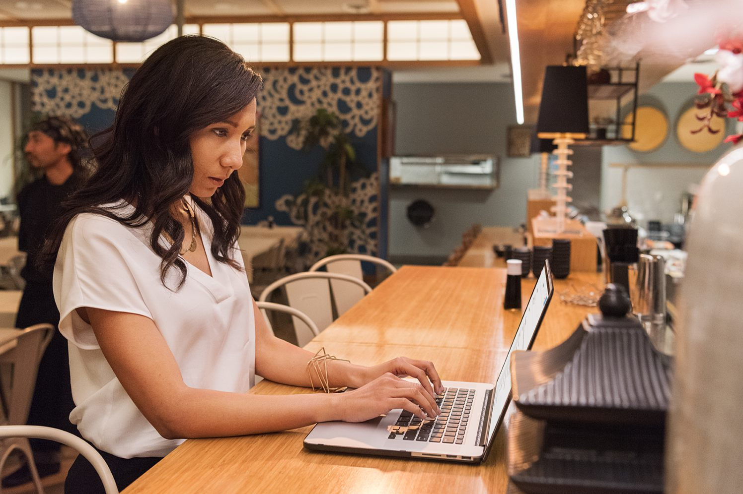 business owner working on her laptop