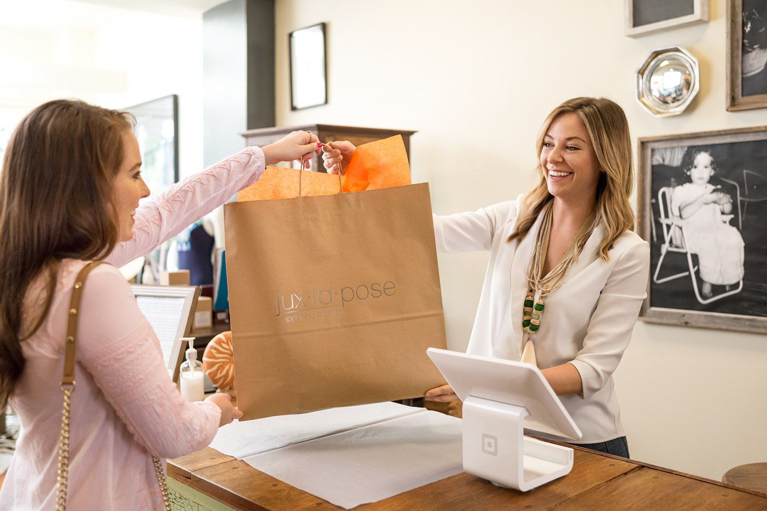 A trained cashier handing over a purchase