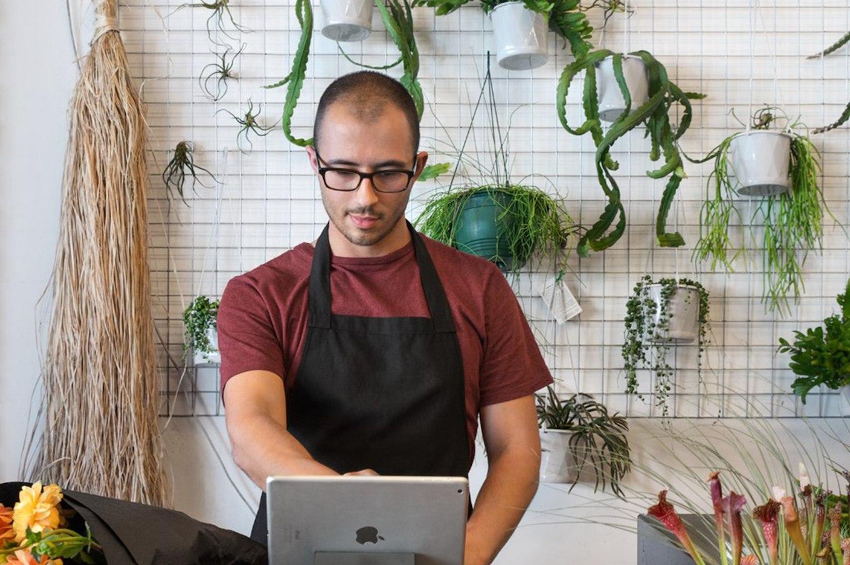 man on tablet at florist shop