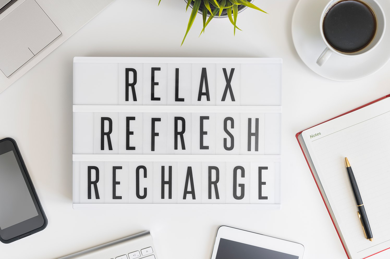 relax sign on a desk