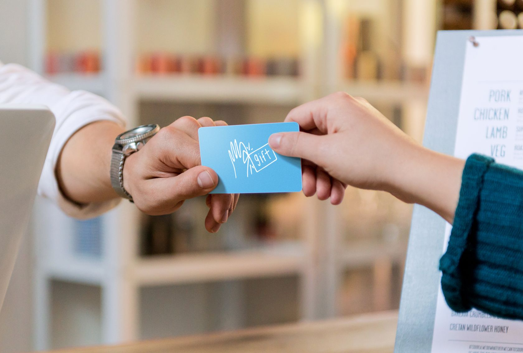 Handing gift card across counter