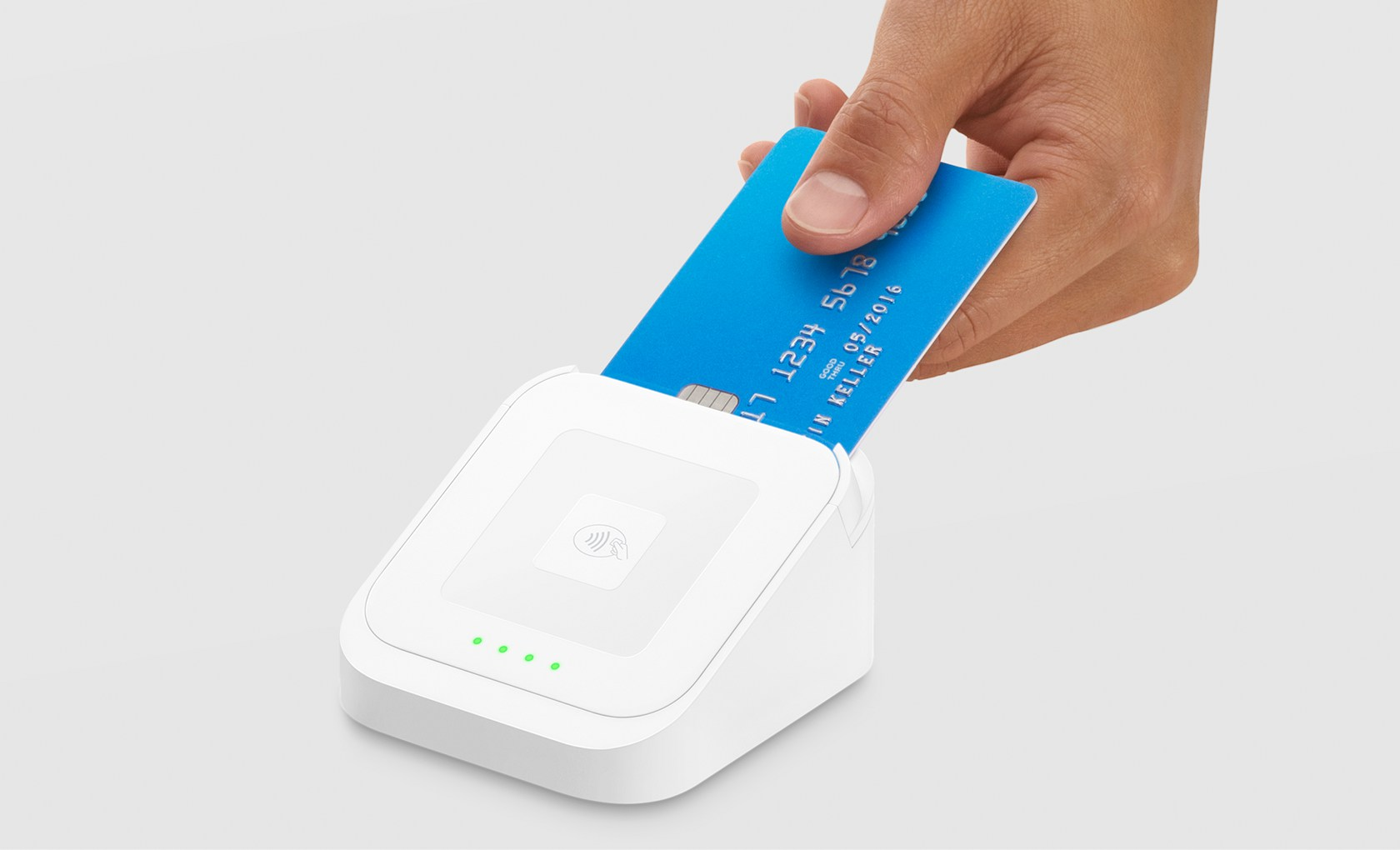 Photo of a hand dipping a chip card into the Square Reader