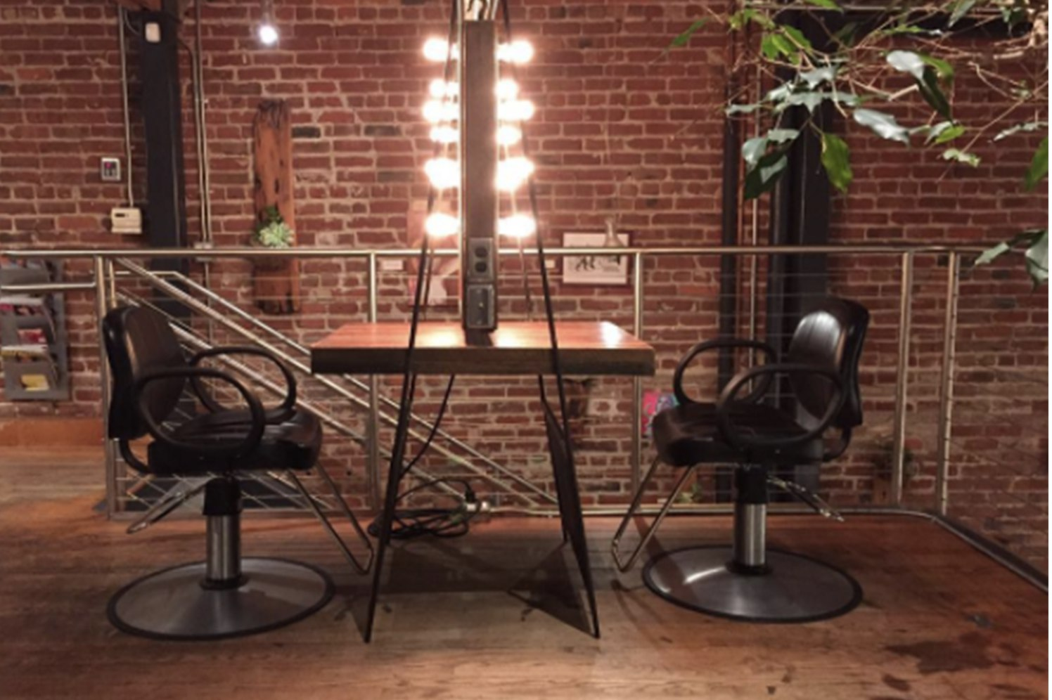 salon chairs with a brick wall in the background