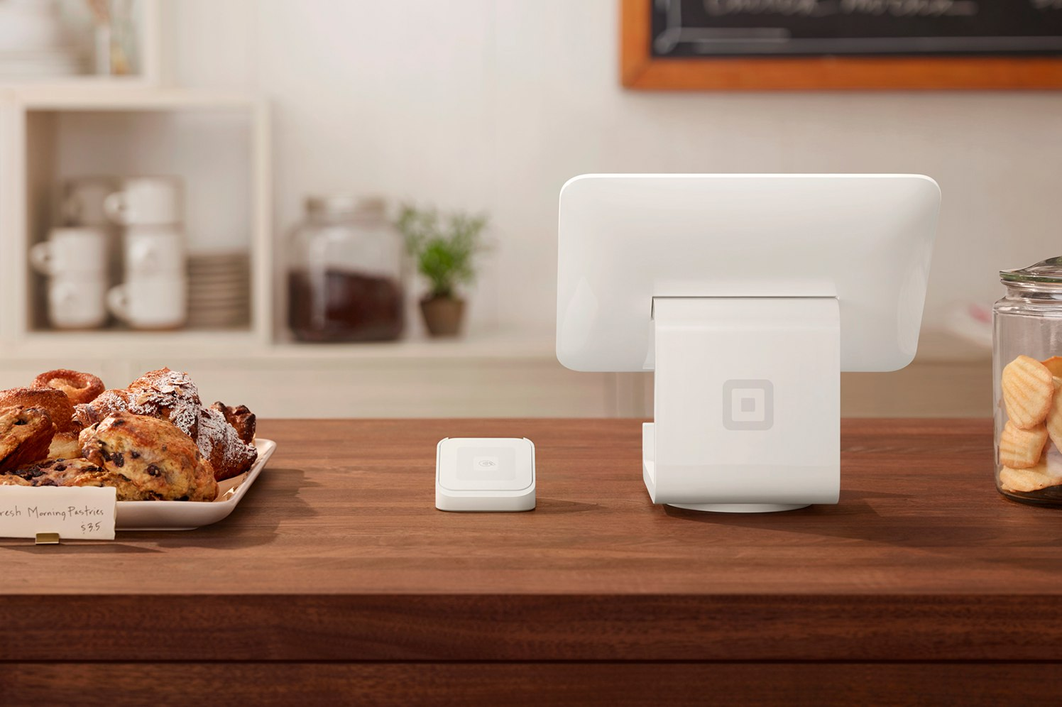 countertop with square POS and pastries