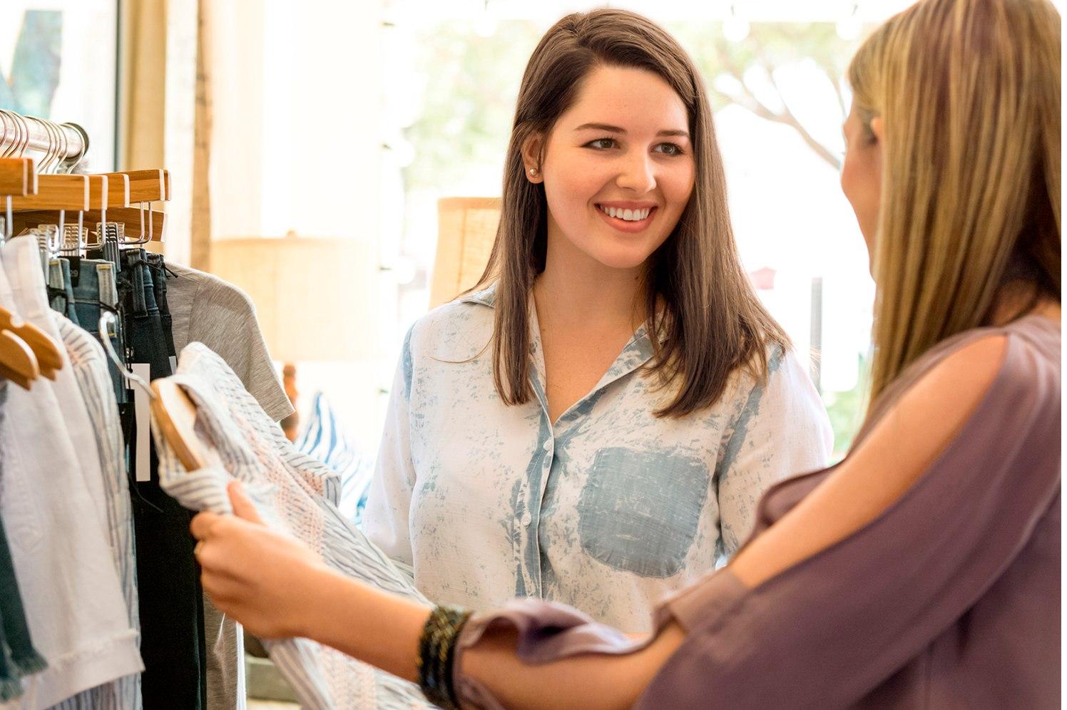 women examining clothing