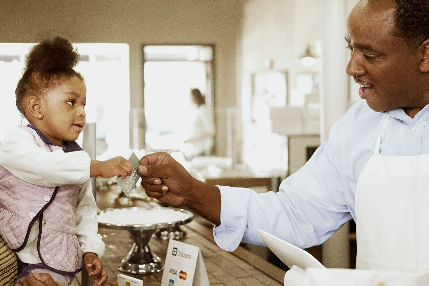 business owner with young customer