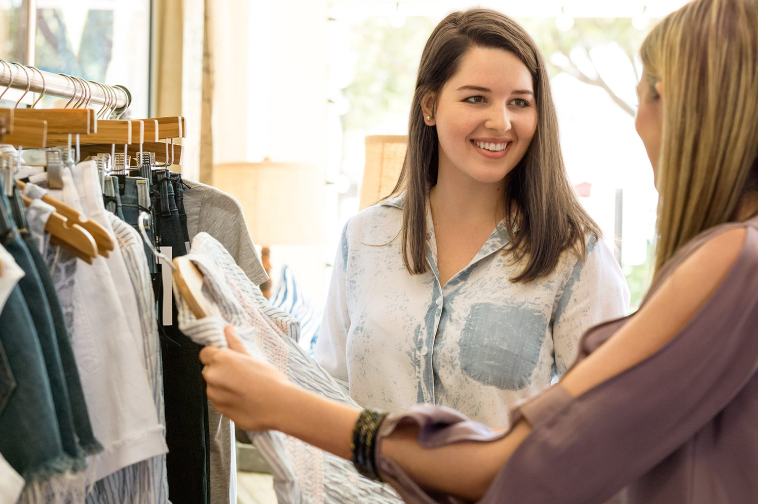 woman with customer at retail store