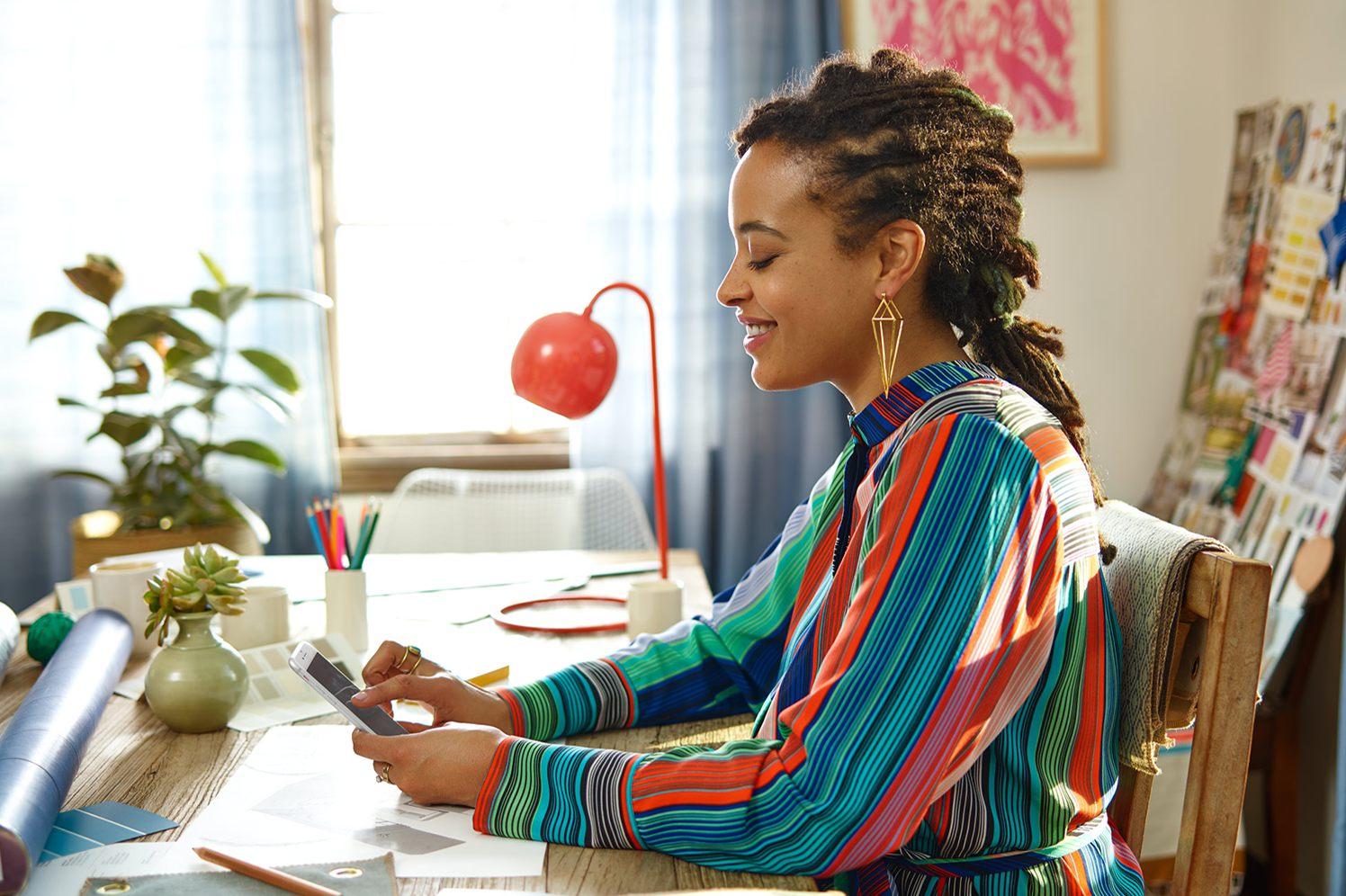 interior designer on her smart phone using square