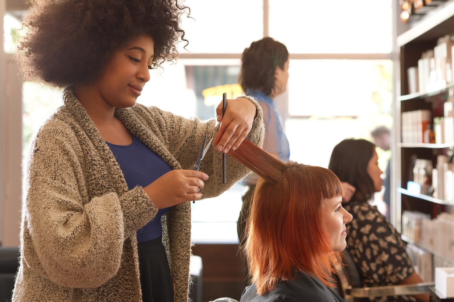 hair stylist and customer in salon